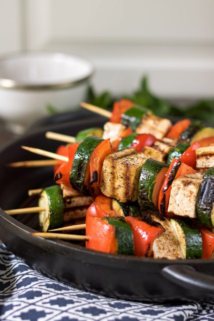 Pan of cooked tofu veg skewers.