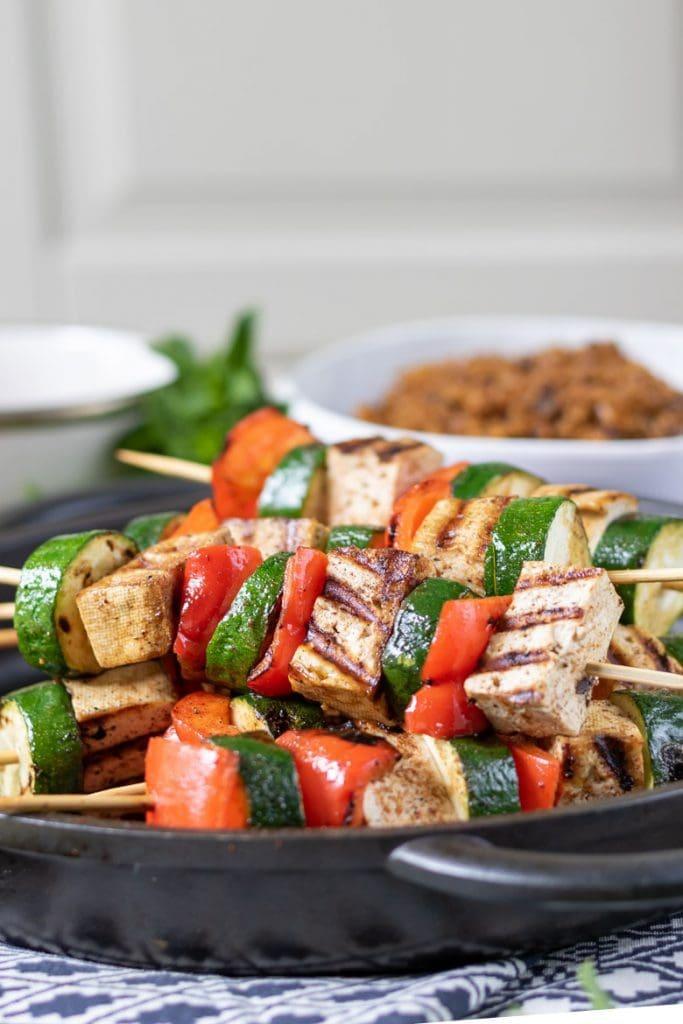 Pile of tofu and vegetable skewers.