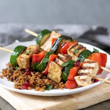 Tofu and Vegetable Kabobs on a plate of rice