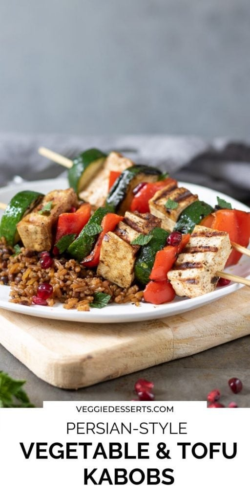 Tofu veg skewers on a plate, text overlay for pinterest