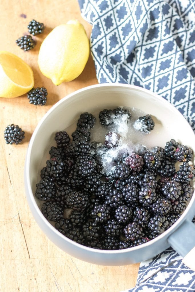 Pot of blackberries and sugar.
