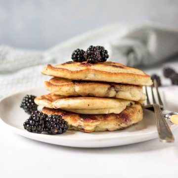Stack of pancakes with blackerries.