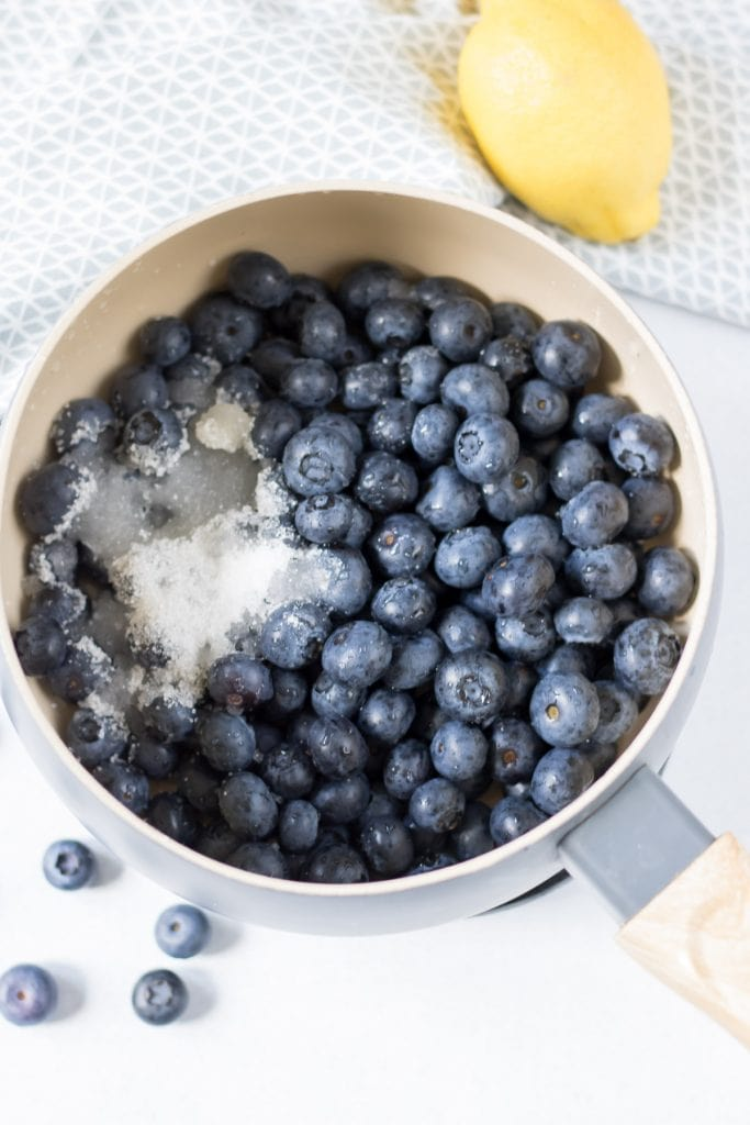Blueberries, sugar and lemon juice in a pot.