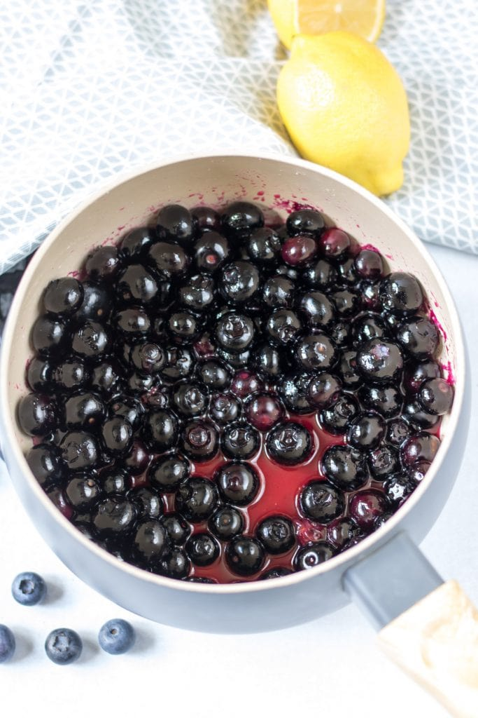 Cooked blueberries in a pot.