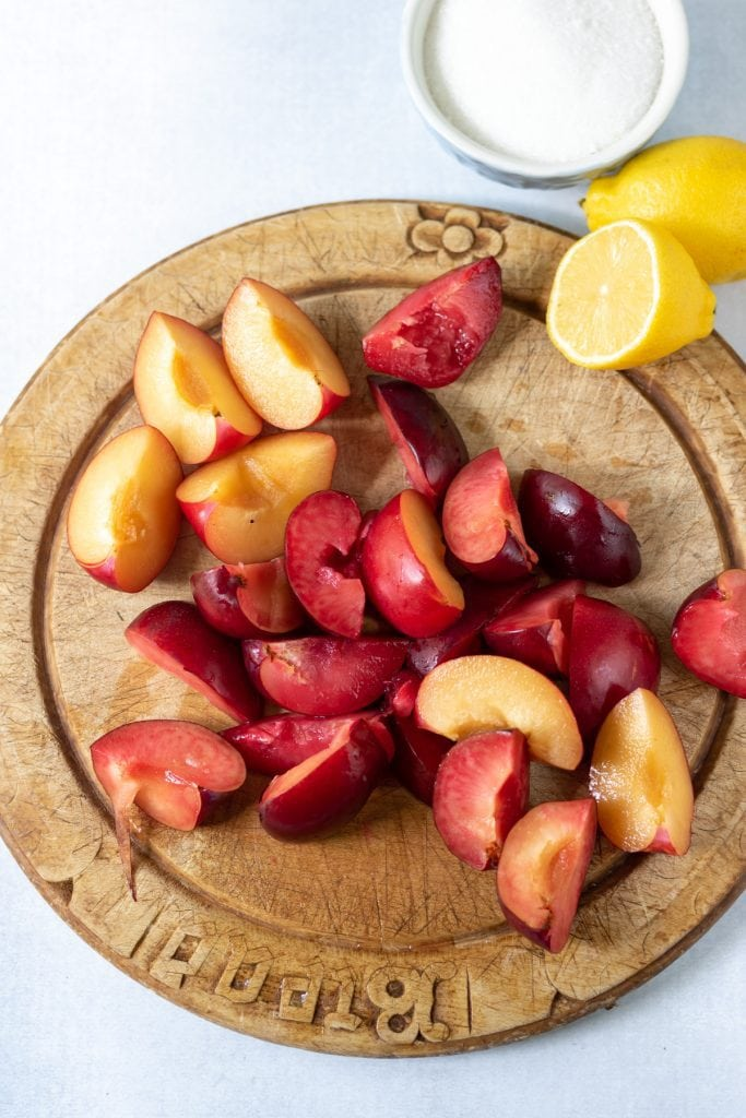 Chopped plums on a wooden board.