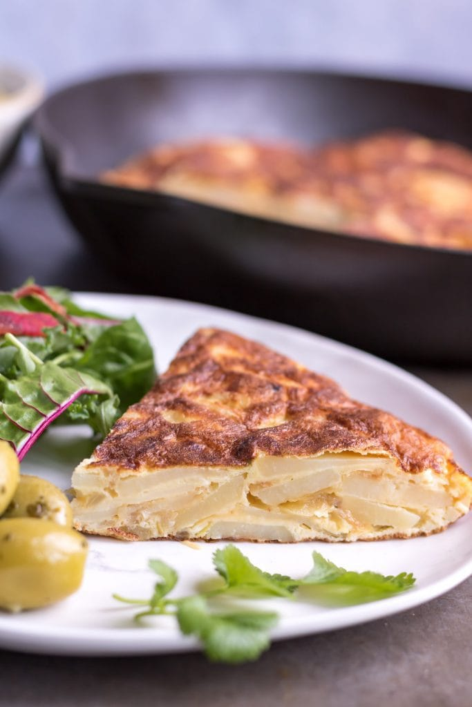 Close up of a piece of Spanish potato omelette.