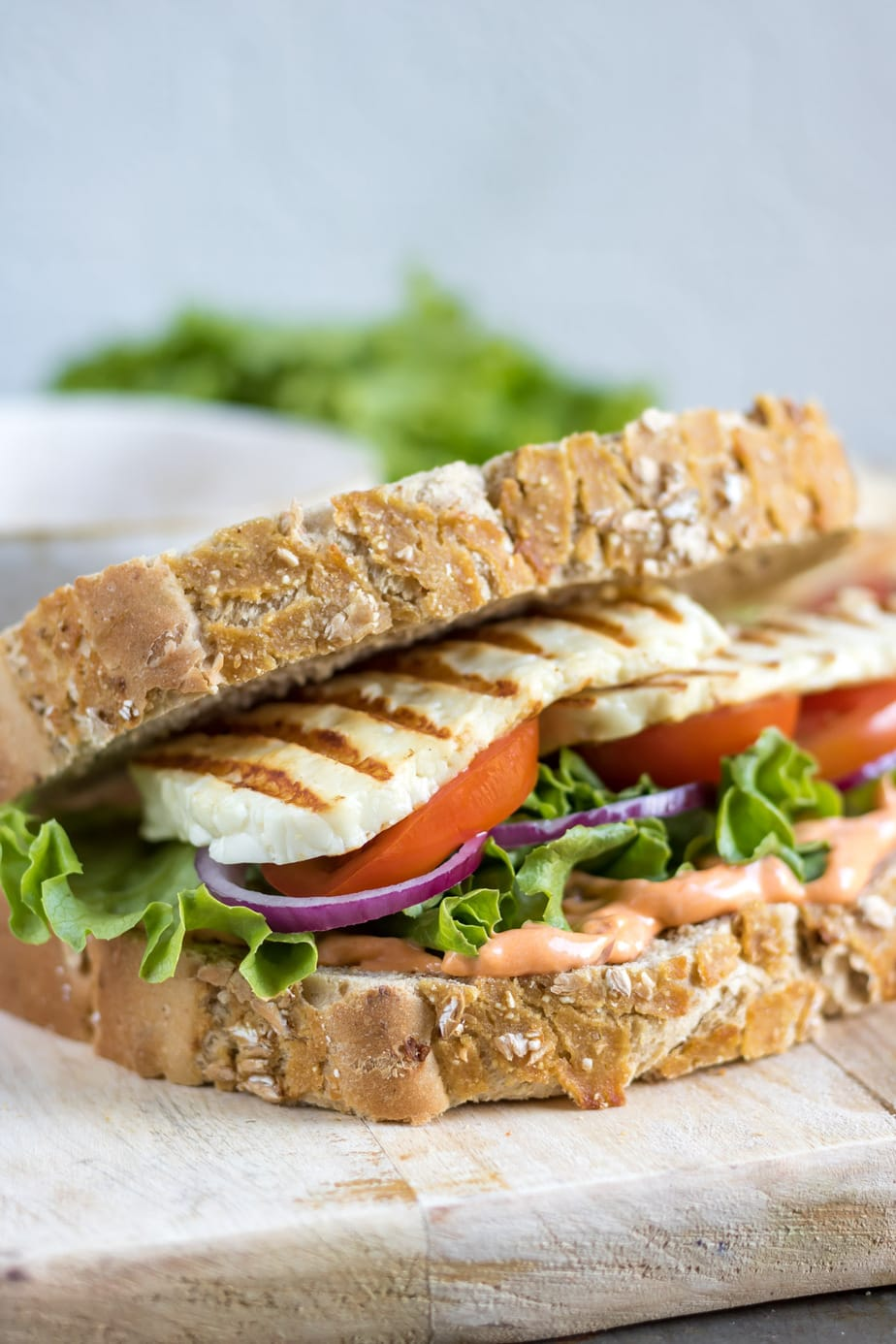 Close up of halloumi in a sandwich.