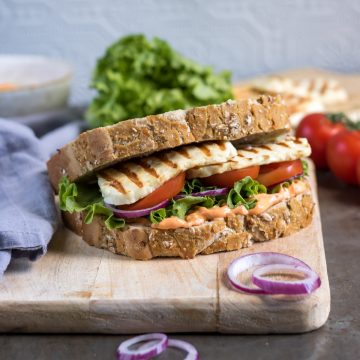 Halloumi Sandwich on a bread board.