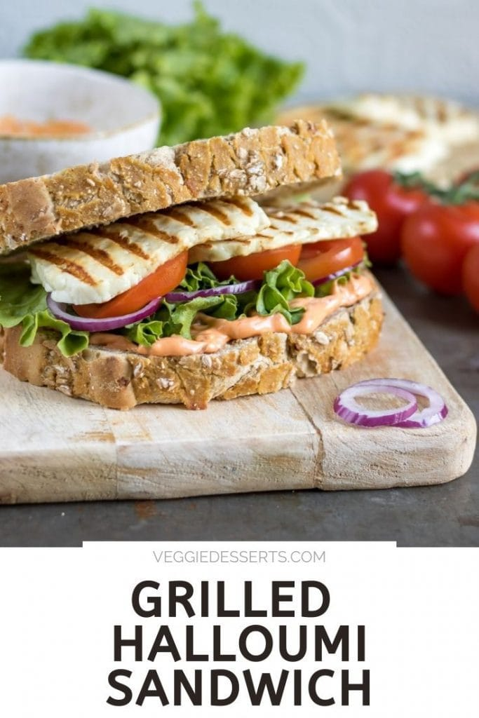 Sandwich on a board, with text: Grilled Halloumi Sandwich.
