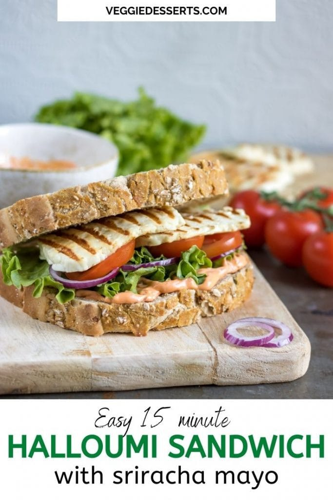 Sandwich on a board, with text: Easy 15 minute Halloumi Sandwich with Sriracha Mayo.