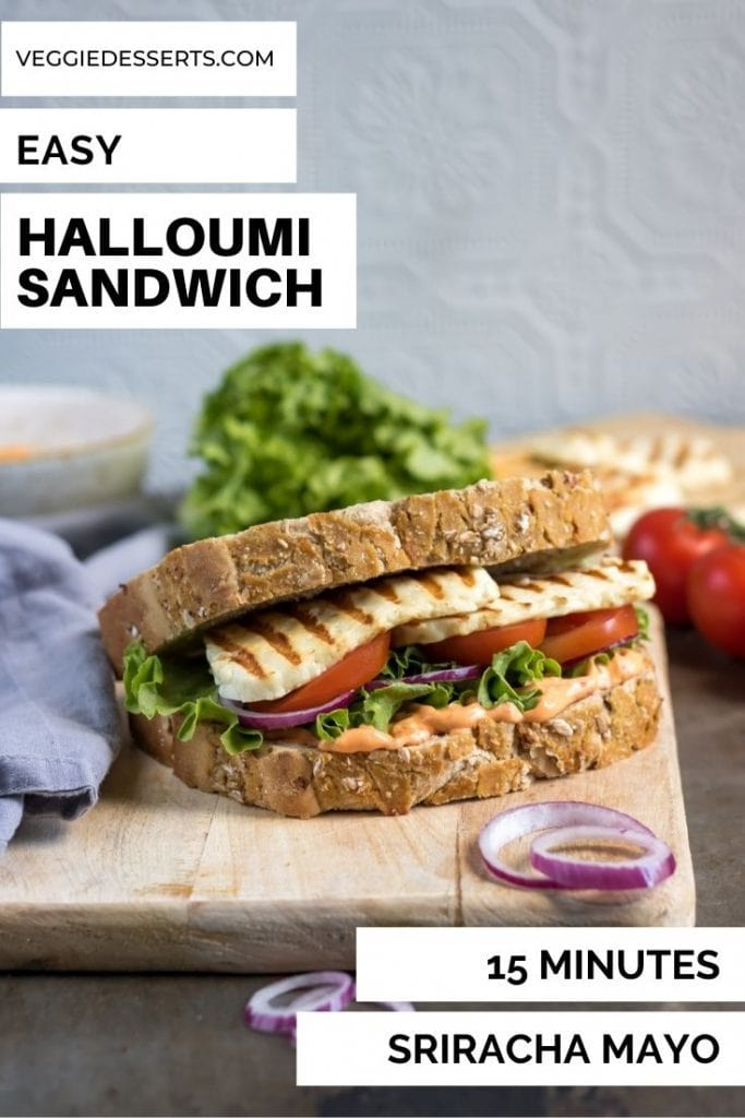 Sandwich on a board, with text: Easy Halloumi Sandwich, 15 minutes, Sriracha Mayo.