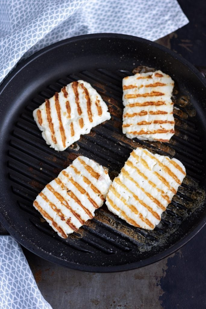 Halloumi grilled in a pan.