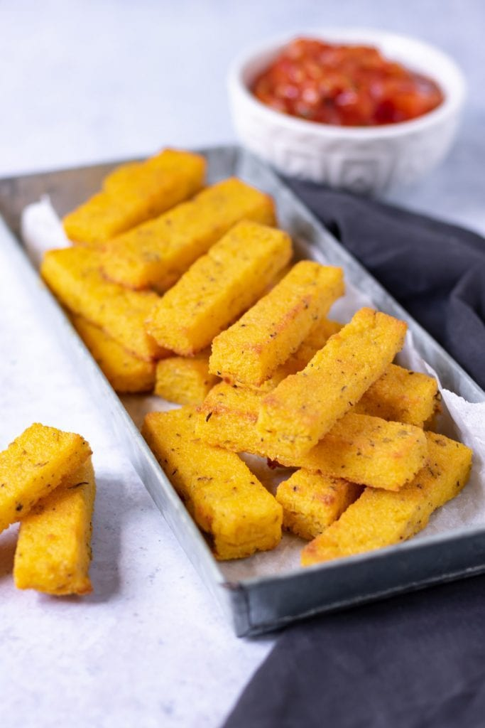 Tray of stacked polenta fries.