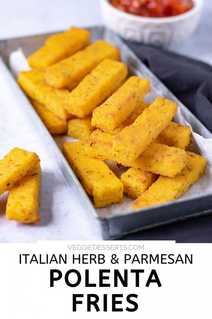 Tray of stacked polenta fries with text that reads Italian Herb & Parmesan Polenta Fries
