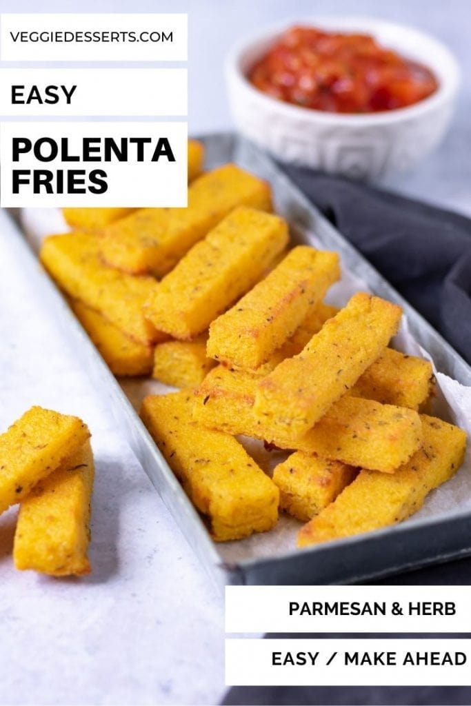 Tray of stacked polenta fries with text overlay that reads Easy Polenta Fries.