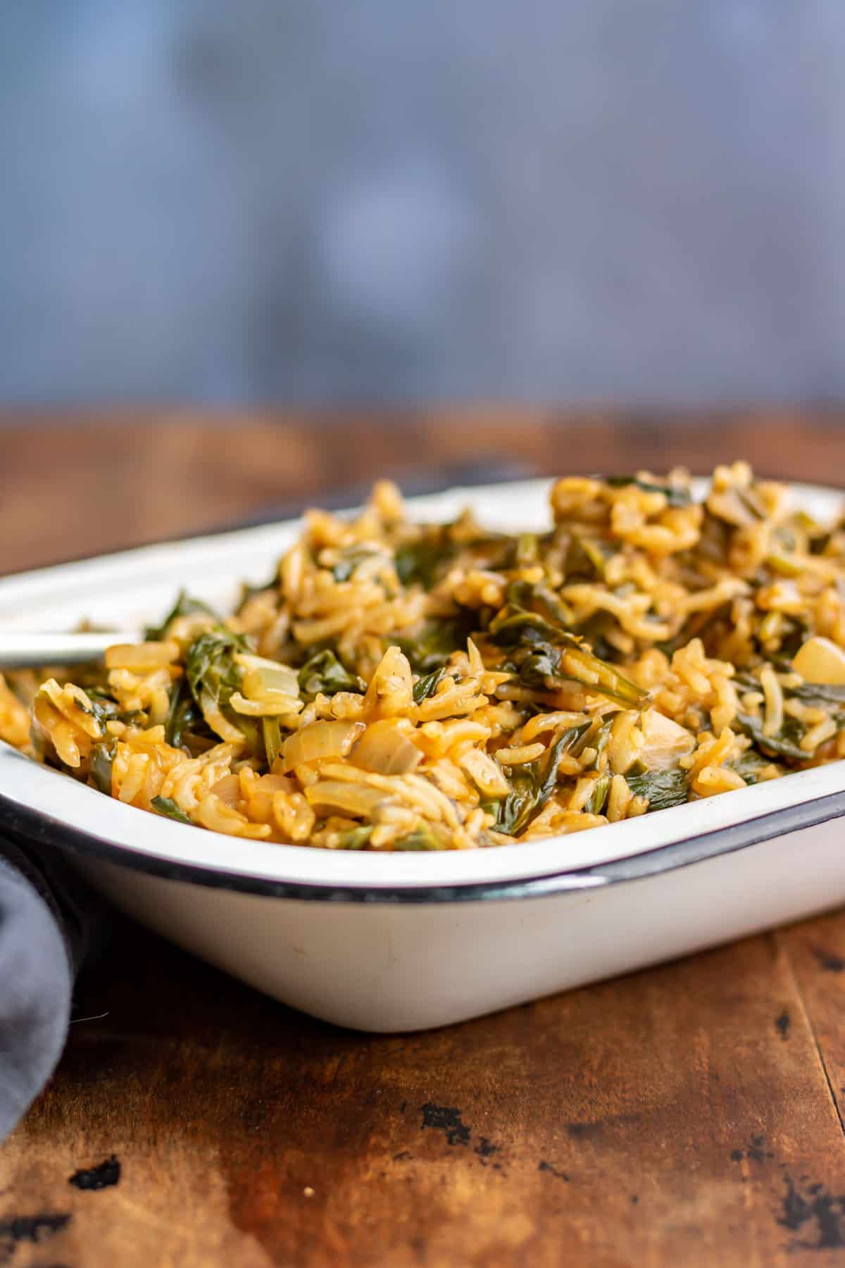 Bowl of rice with spinach.