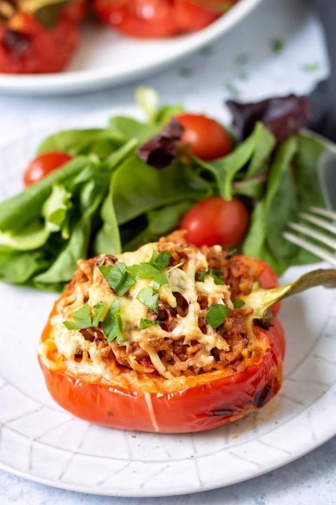 Closeup of stuffed pepper on a plate.