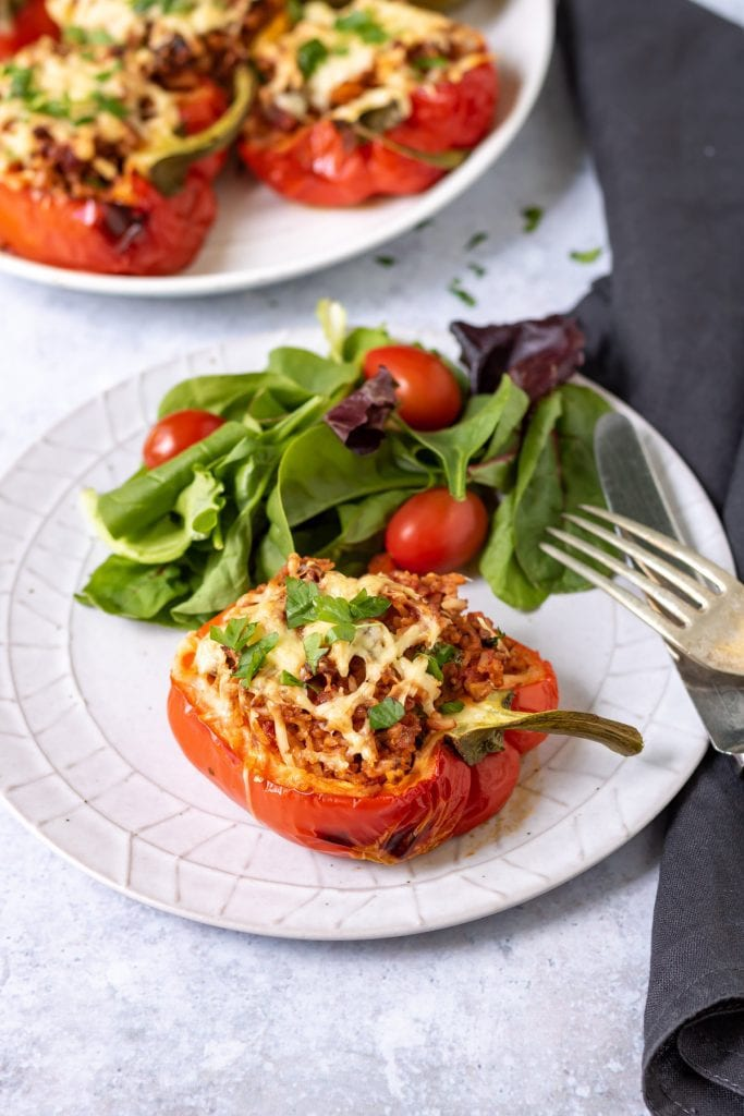 Plate with a vegan stuffed pepper and salad.