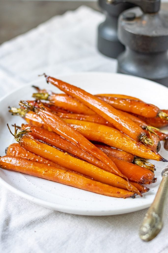 Close up of a serving dish of maple carrots.