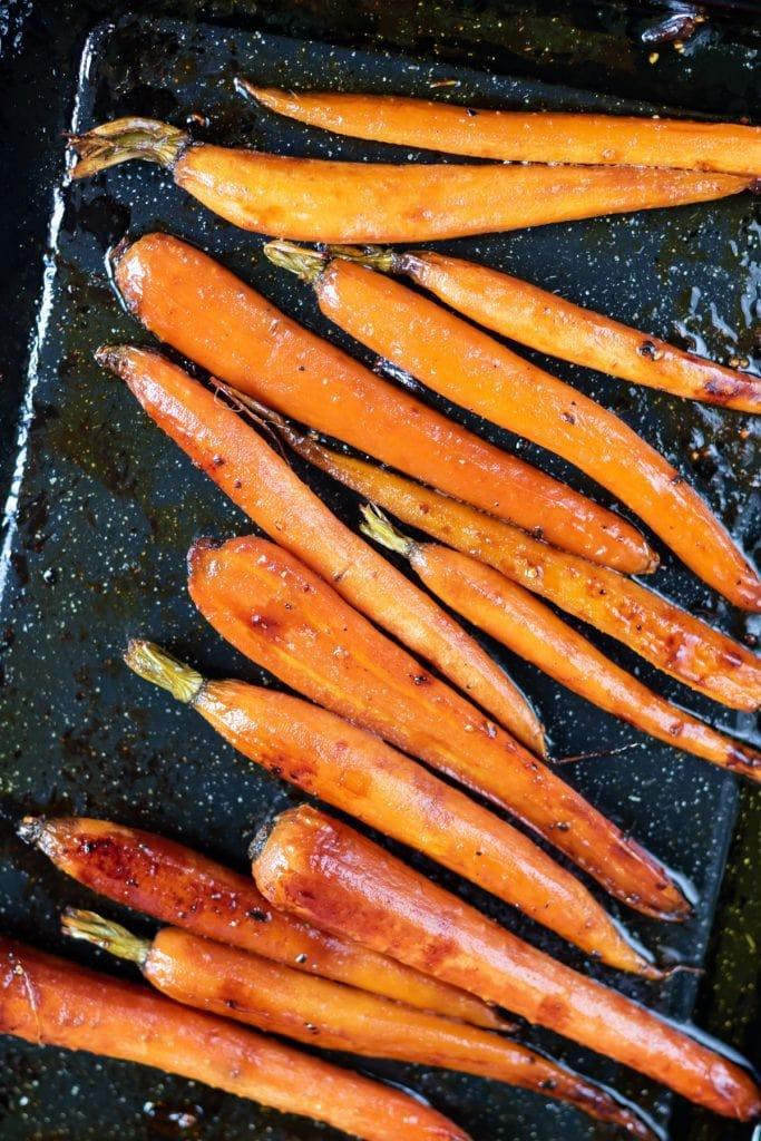 Roasted carrots on a baking tray.