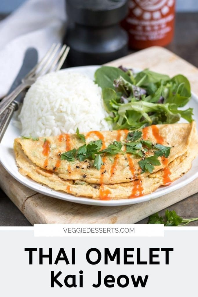 Omelet on a plate with rice and salad, text reads Thai Omelet, Kai Jeow.