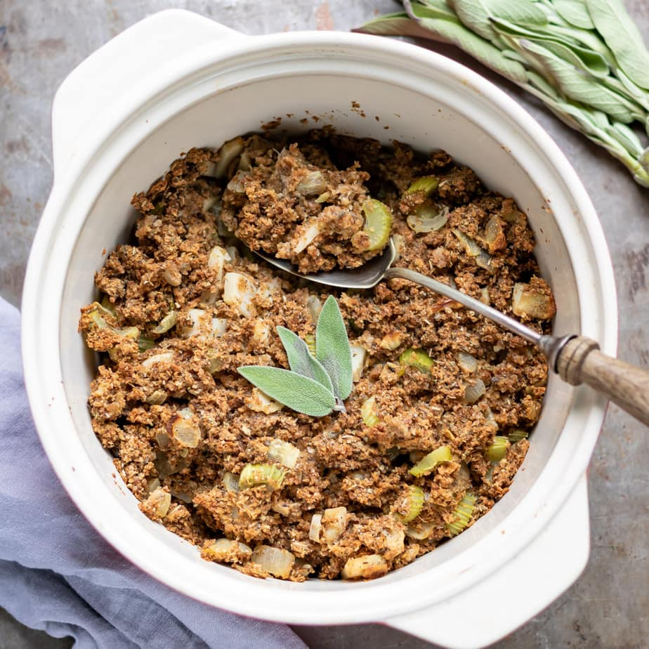 Casserole dish of vegan stuffing with sage on top.