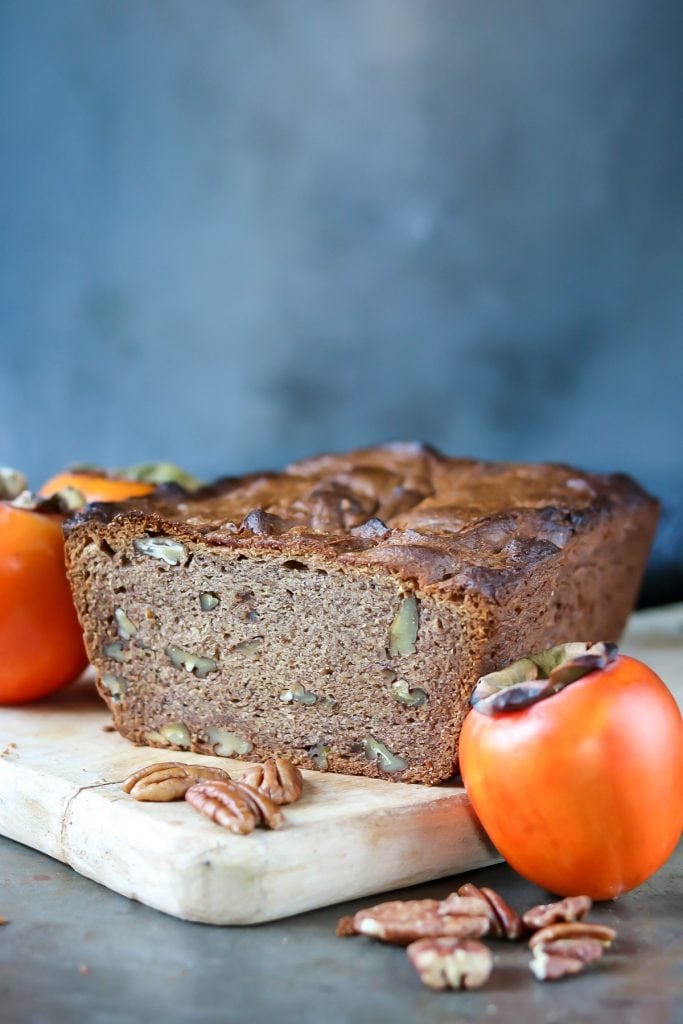 Persimmon loaf next to persimmons