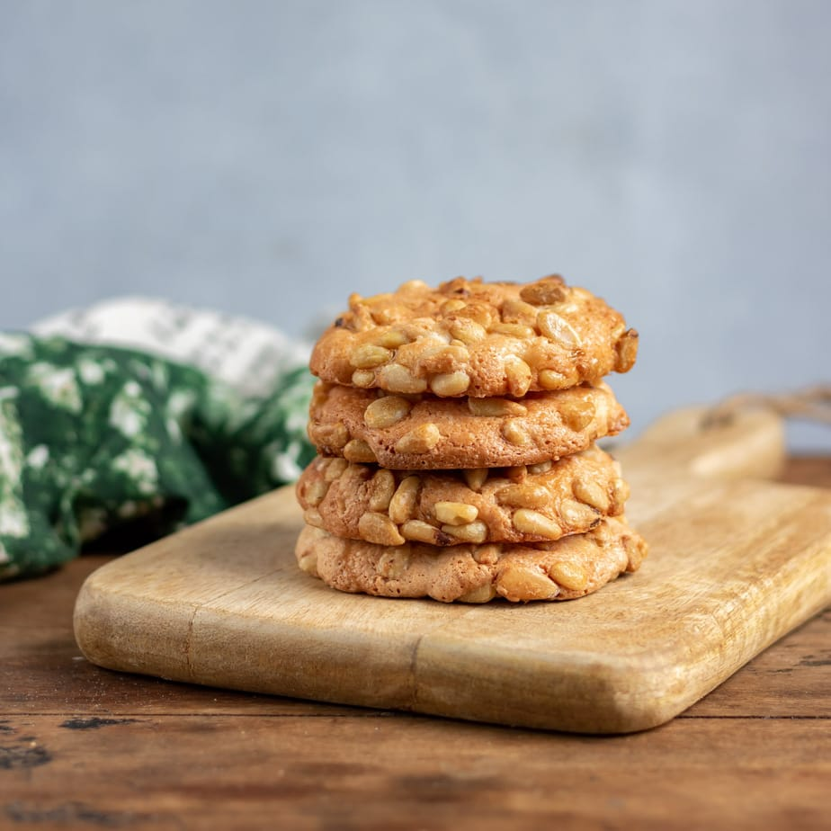 Stack of cookies on a board.
