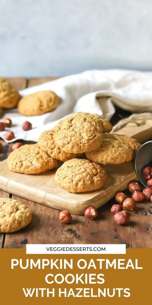 Cookies on a board with text: pumpkin oatmeal cookies with hazelnuts.