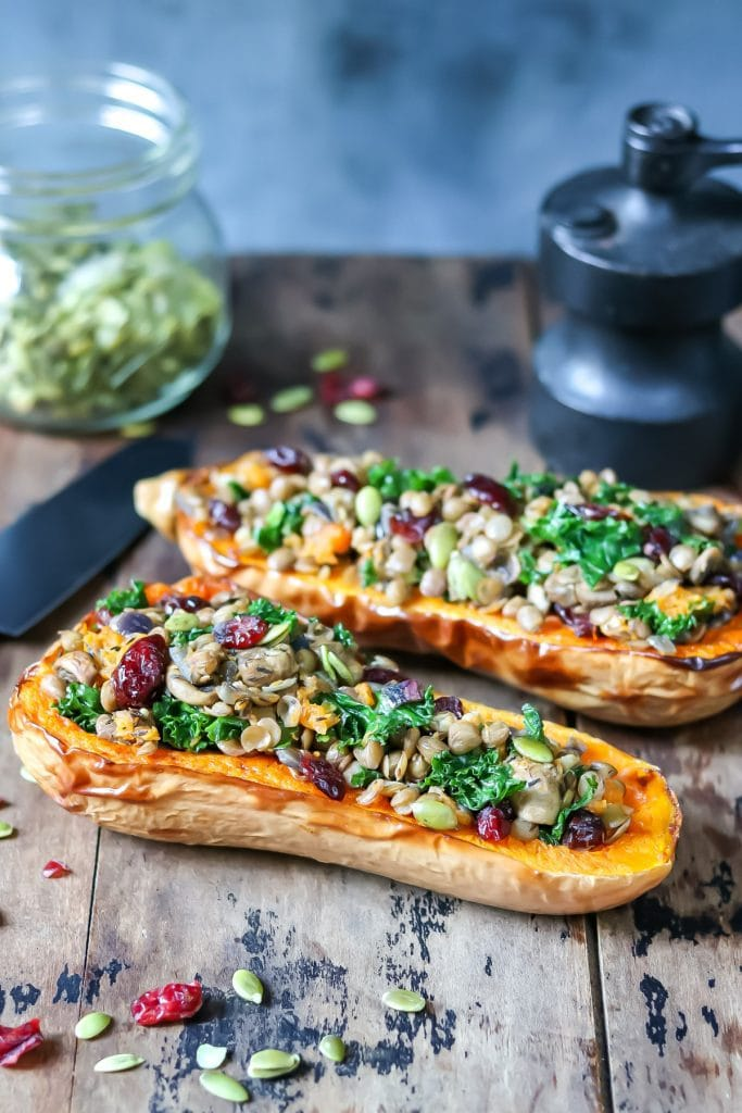 Table with lentil kale stuffed butternut squashes.
