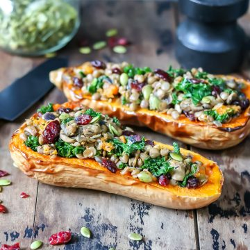 Stuffed squash halves on a table.