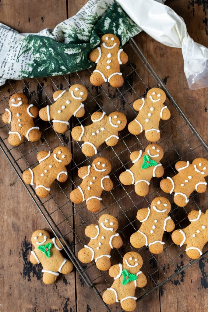 Cooling rack of decorated gingerbread men.