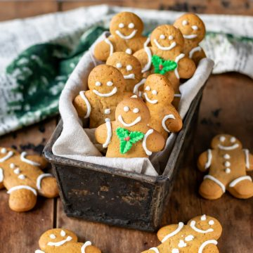 Box full of decorated gingerbread men.