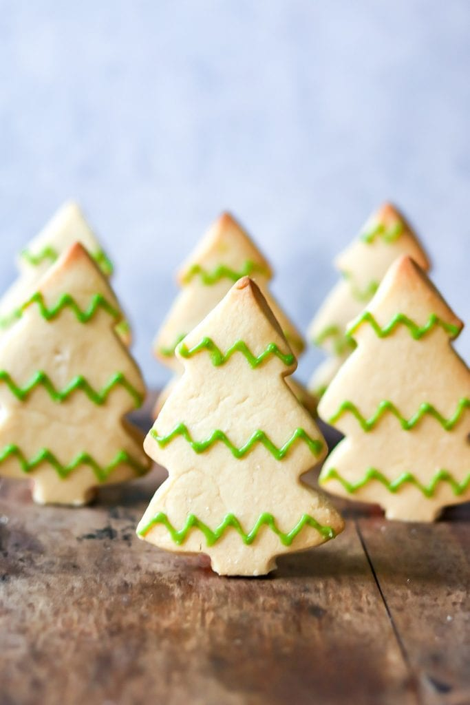Tree shaped cookies stood up.