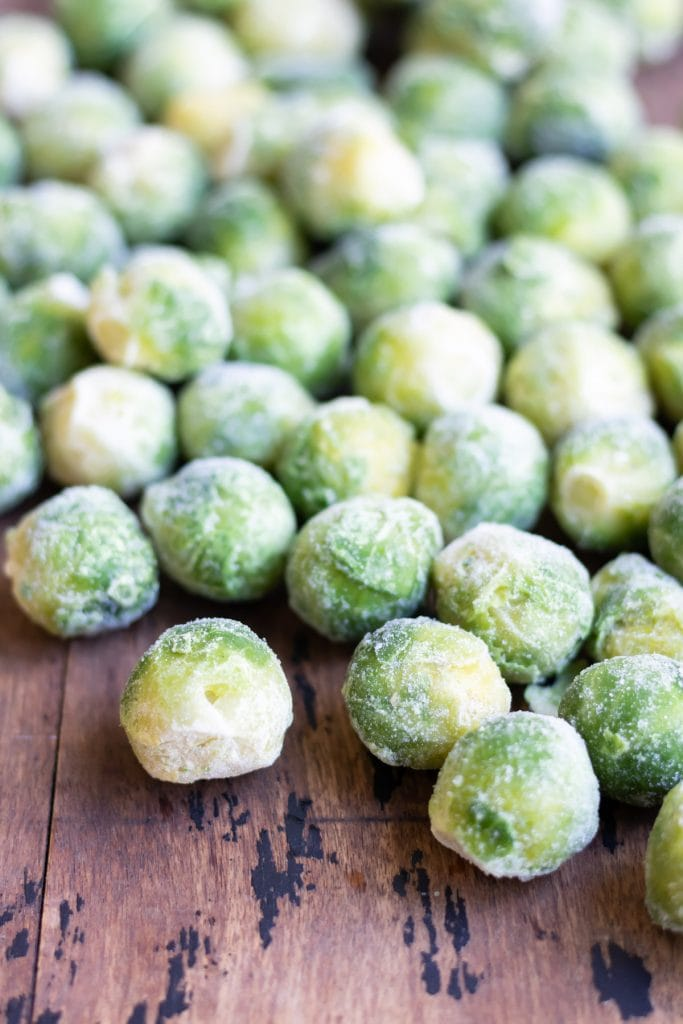 Frozen sprouts on a board.