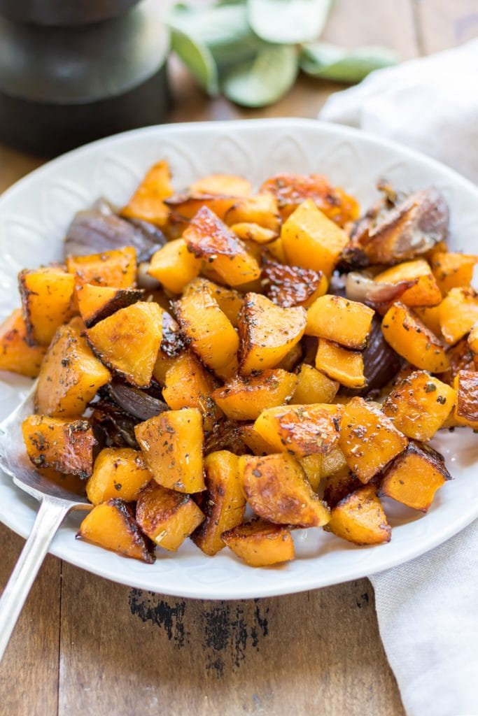 Close up of a serving dish of roasted squash.