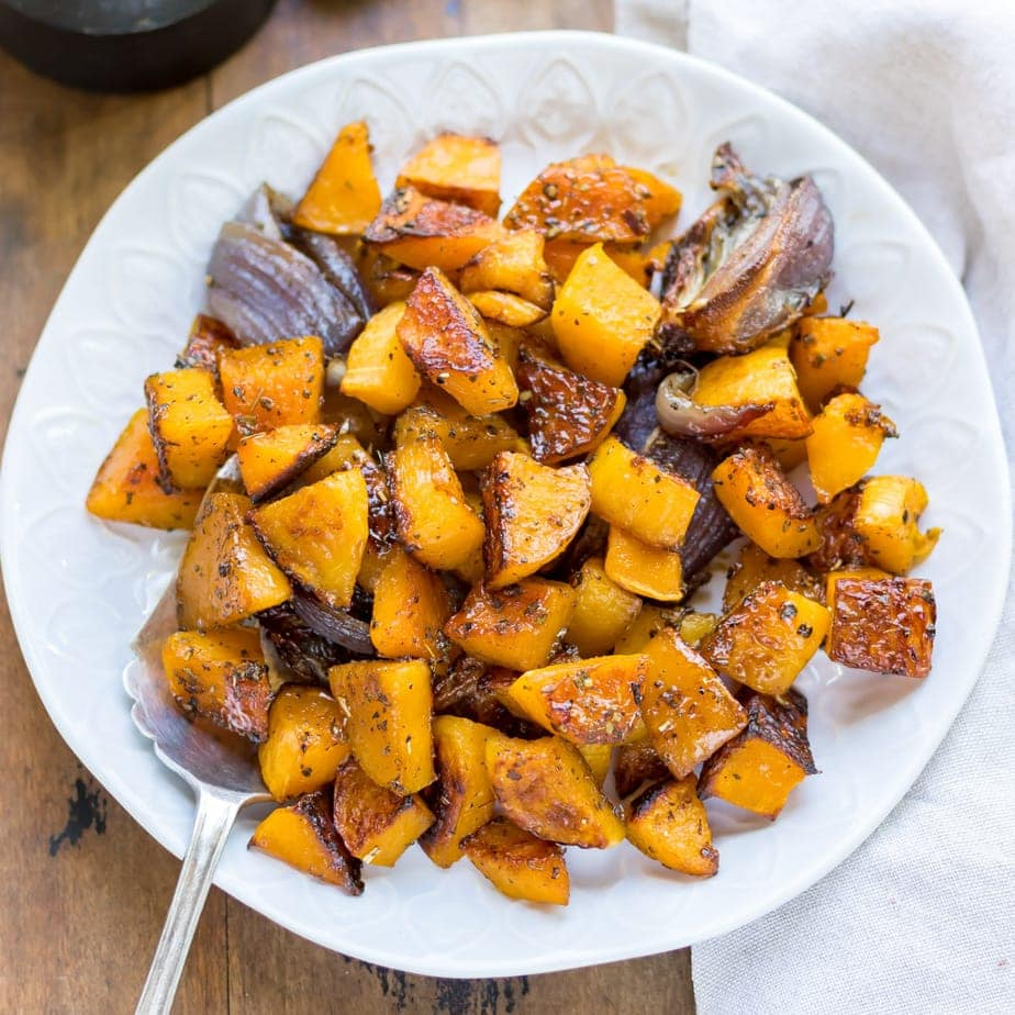 Bowl of roasted squash with maple syrup.