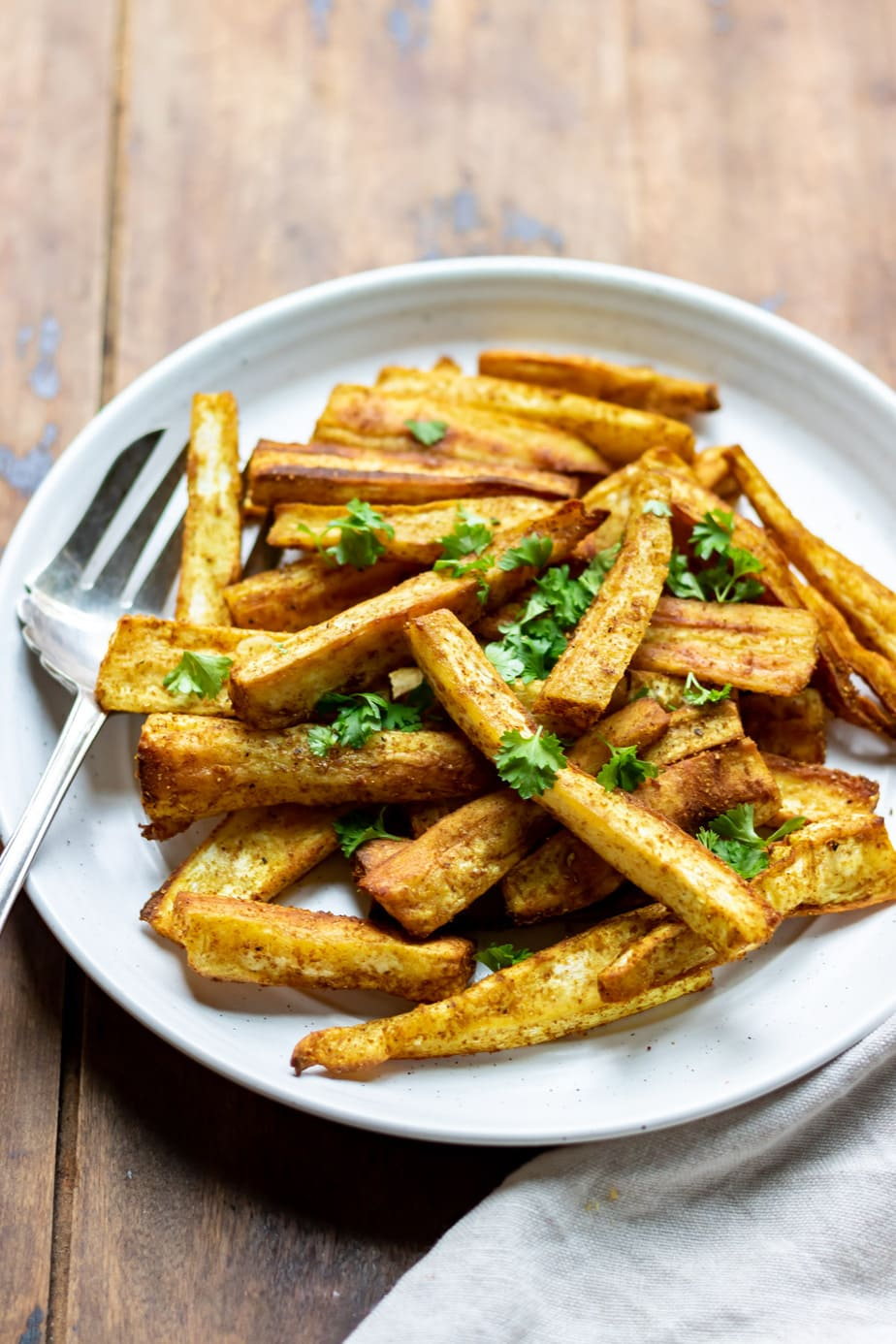 Plate of roasted parsnip with curry flavorings.