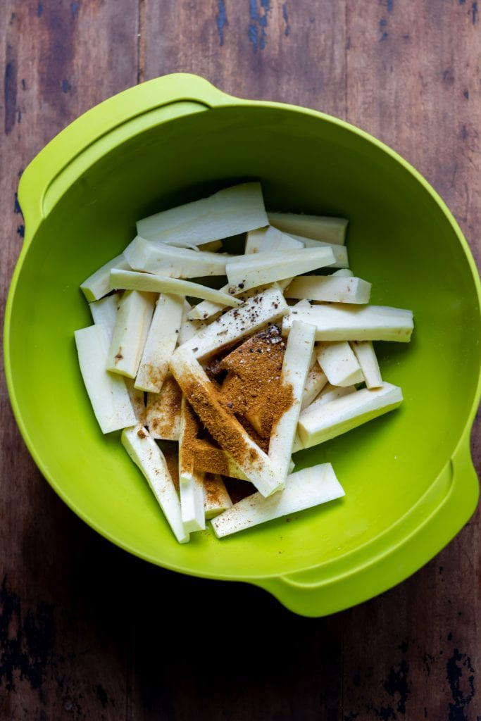 Bowl of parsnip strips and spices.