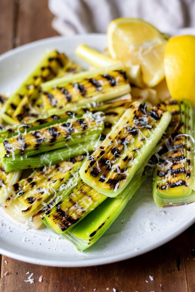 Close up of grilled leeks on a plate.