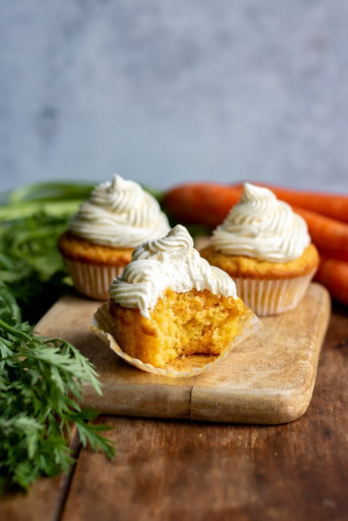 Close up of a cupcake with a bite out.