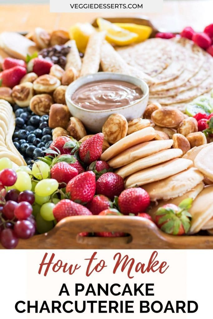 Tray of pancakes and fruit with text: How to make a pancake charcuterie board.