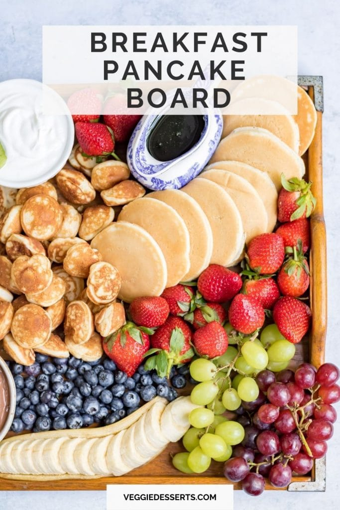 Platter of pancakes and fruit with text: Breakfast Pancake Board