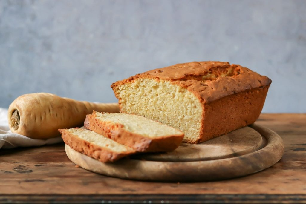 wide view of a loaf cake cut into slices.