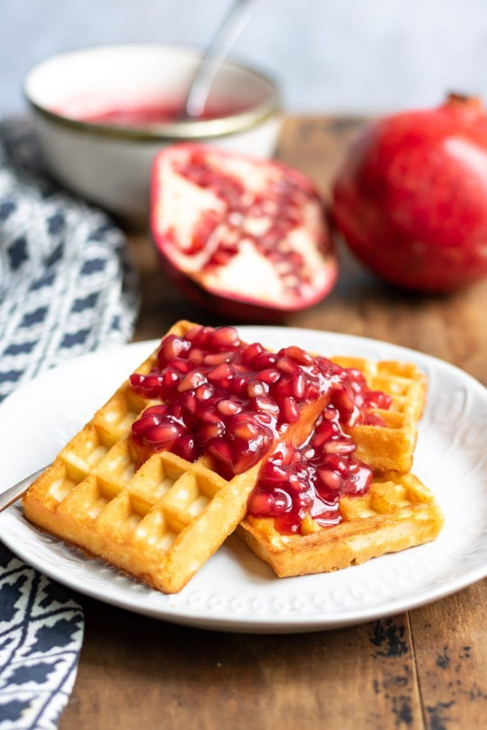 Waffles with compote on them.