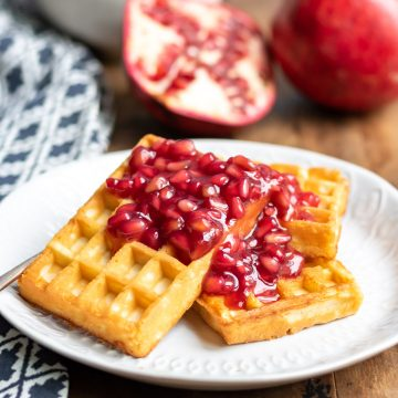 Waffles with pomegranate compote on them.