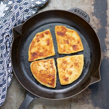 Skillet with potato farls in it.
