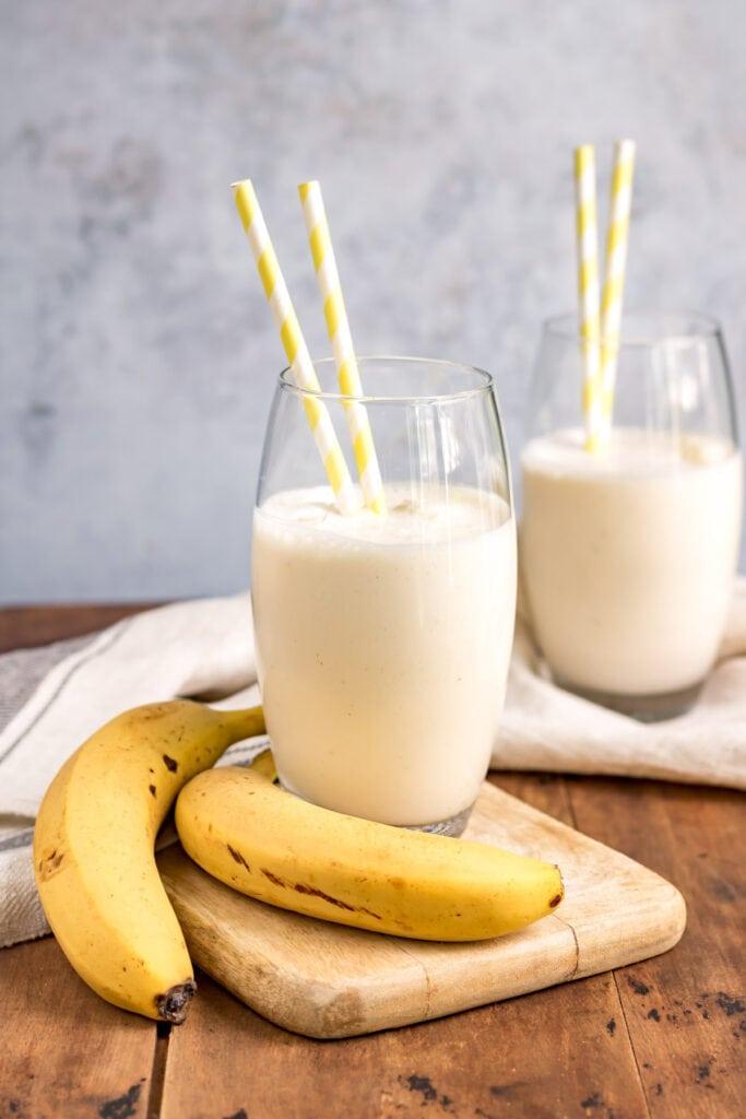 Bananas and glasses of banana lassi.