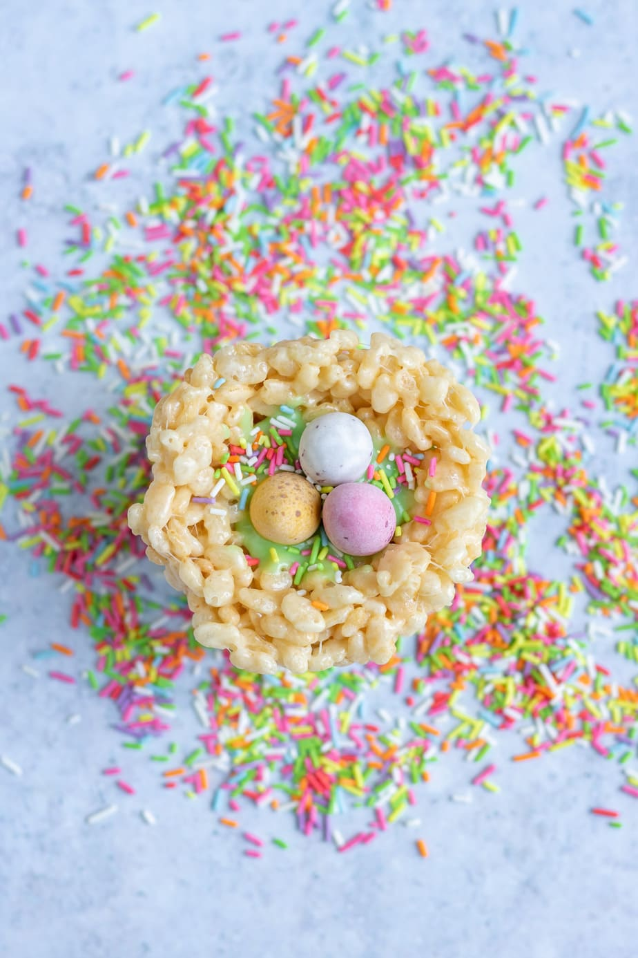 Single rice krispie nest with sprinkles scattered around.