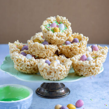 Serving platter with rice crispie treats shaped into nests.